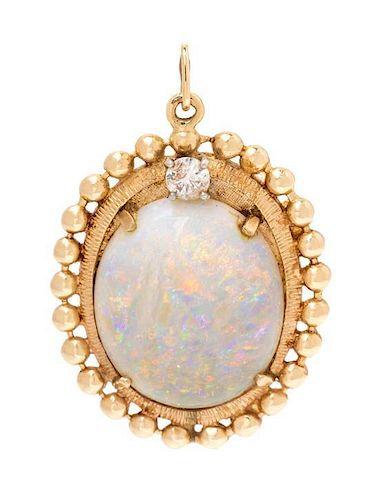 A 14 Karat Yellow Gold, Opal and Diamond Pendant, 6.70 dwts