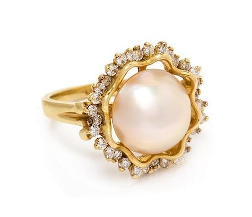 An 18 Karat Yellow Gold, Cultured Mabe Pearl and Diamond Ring, 5.50 dwts.