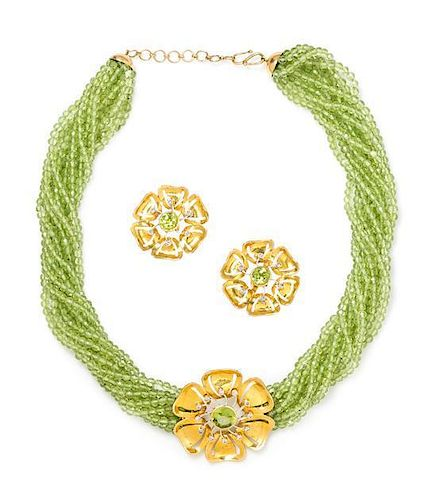 A Yellow Gold, Peridot and Diamond Floral Motif Demi-Parure, 49.50 dwts.