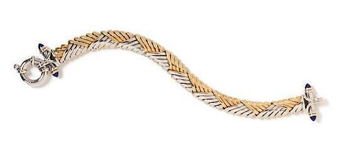 * A 14 Karat Bicolor Gold and Lapis Lazuli Bracelet, Italian, 17.80 dwts.