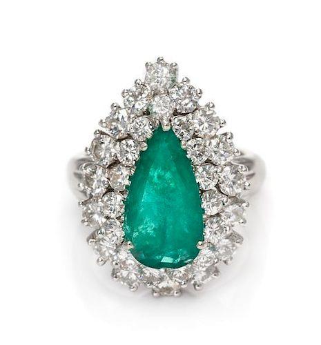 * A 14 Karat White Gold, Emerald and Diamond Ring, 5.40 dwts.