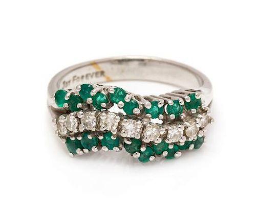 A 14 Karat White Gold, Emerald and Diamond Ring, 3.50 dwts