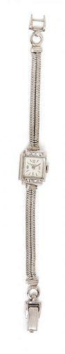 * A Retro 14 Karat White Gold and Diamond Wristwatch, Croton, 13.40 dwts.