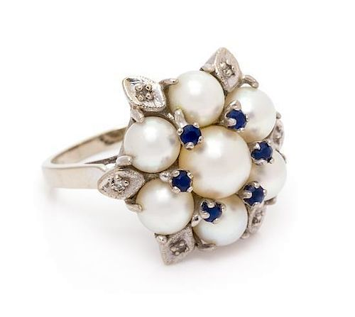 A 14 Karat White Gold, Cultured Pearl, Sapphire and Diamond Ring, 6.37 dwts.