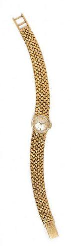 A 14 Karat Yellow Gold Wristwatch, Omega, 20.30 dwts.