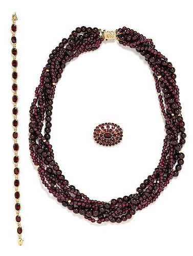 * A Collection of 14 Karat Yellow Gold and Garnet Jewelry, 93.95 dwts.