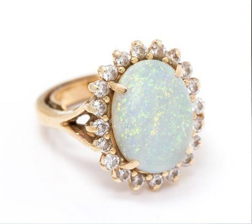 A Yellow Gold, Opal and Diamond Ring, 4.20 dwts.