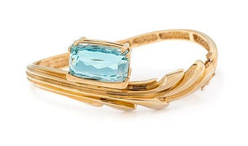 * A Yellow Gold and Aquamarine Bangle Bracelet, 24.20 dwts.