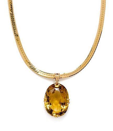 * A 14 Karat Yellow Gold Citrine Pendant/Necklace, 10.30 dwts.