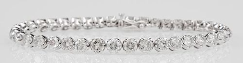 14K White Gold Tennis Bracelet, each of the 40 links mounted with a round diamond, total diamond weight- 8.12 cts., L.- 7 3/8