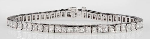 14K White Gold Tennis Bracelet, each of the fifty-six links with a princess cut diamond, total diamond weight- 8.55 carats, L