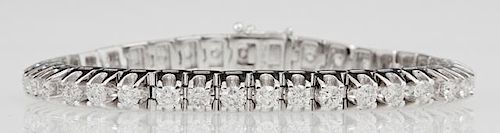 14K White Gold Tennis Bracelet, each of the 37 links mounted with a round diamond, total diamond weight- 7.81 cts., L.- 7 1/2