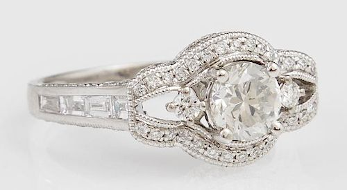 Lady's Platinum Dinner Ring, with a central .8 carat diamond within a pierced lobed border of round diamonds, the shoulders o
