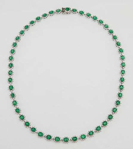 """Platinum Necklace, each of the fifty links with an oval emerald atop a border of round diamond """"points,"""" total emerald weight"""