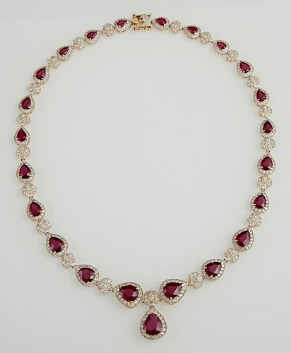 14K Yellow Gold Link Necklace, each of the 22 links with a graduated pear shaped ruby atop of border of round diamonds, joine