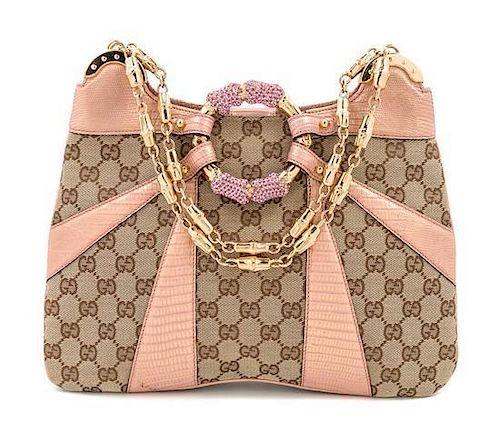 "A Gucci Monogram Canvas and Pink Python Handbag, 12"" x 8.5"" x 1""; Strap drop: 8""."
