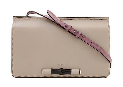 "A Gucci Grey Leather Shoulder Bag, 11.75"" x 7.5"" x 1.5""; Strap drop: 15""."