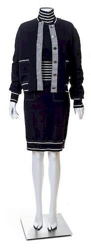 A Chanel Navy Three Piece Jacket and Skirt Ensemble, Jacket and skirt size 42, Top size 40.