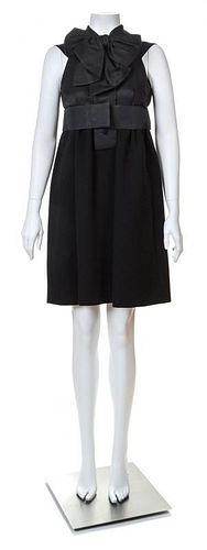 "A Geoffrey Beene Black Wool Cocktail Dress, No size; Belt: 30""- 31.5"" x 2.75""."