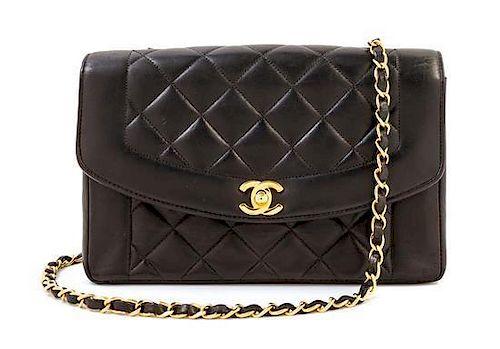 "A Chanel Black Lambskin Flap Shoulder Bag, 9.5"" x 6.5"" x 3""; Strap drop: 21""."