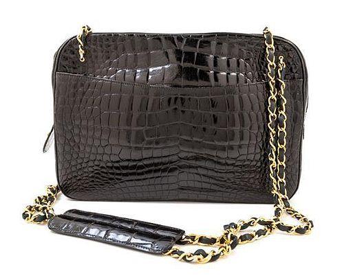 "A Chanel Black Crocodile Handbag, 11.5"" x 8"" x 2.5""; Strap drop: 16""."