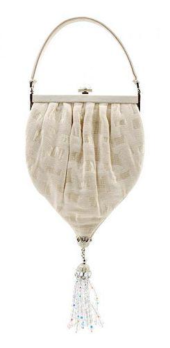 "A Judith Leiber Cream Silk Textured Handbag, 5.5"" x 10"" x 1""; Handle drop: 3""."