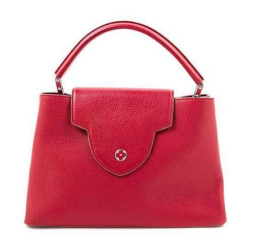 "Louis Vuitton Red Taurillon Capucines MM Handbag, 14"" x 9"" x 5.5""; Handle drop: 5""."