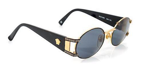A Pair of Versace Goldtone Round Framed Sunglasses,