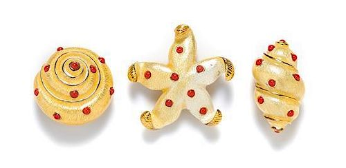 A Group of Carolee Goldtone Starfish and Shell Brooches,