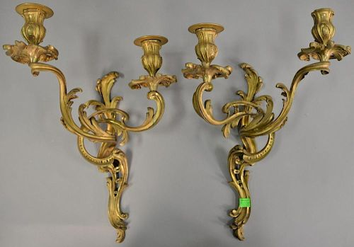 Pair of French two light brass sconces. ht. 15 1/2in., wd. 10 1/2in.   Provenance: The Estate of Thomas F Hodgman of Fairfiel