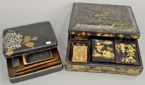 Two black lacquered boxes including writing or calligraphy box Suzuribako with heavy gold leaves and mother of pearl decorati