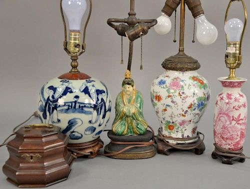Five piece lot to include four Chinese table lamps: blue and white ginger jar (ht. 8in.), green and yellow glazed figure, sma