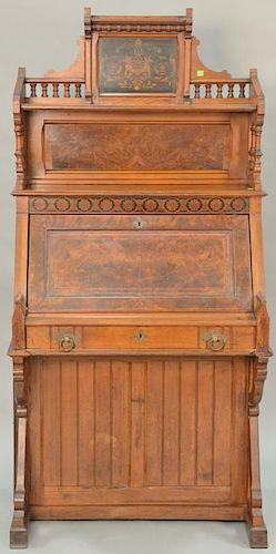Victorian walnut and burl walnut desk with putti inlaid top and floral inlay over lid with two side doors. ht. 67 1/2 in., wd