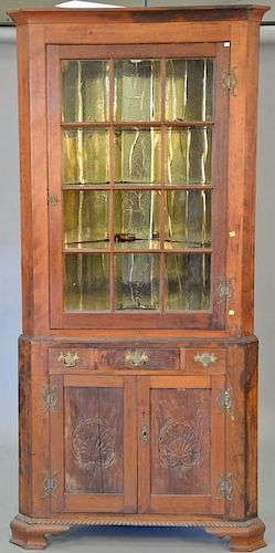 Custom corner cabinet in two parts. ht. 88 in., wd. 40 in., dp. 19 in.  Provenance: From the Estate of Faith K. Tiberio of Sh