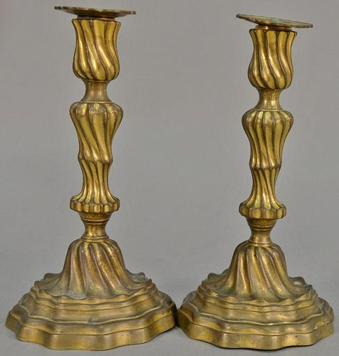 Pair of Continental candlesticks retaining some original gilt, probably 18th century. ht. 9 3/4in.   Provenance: The Estate o