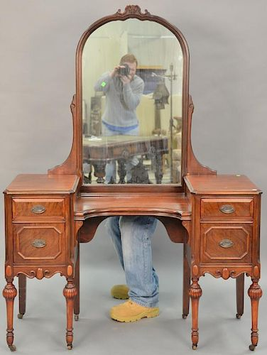 Two piece lot to include a mahogany vanity with mirror ht. 67in., wd. 49 1/2in. and a Chippendale style wing chair.  Provenan