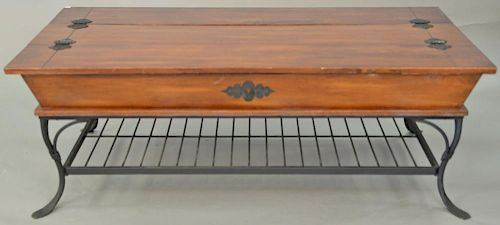 """Coffee table with lift tops and iron base. ht. 19 in., top: 29"""" x 52""""  Provenance: Property from the Estate of Frank Perrotti"""