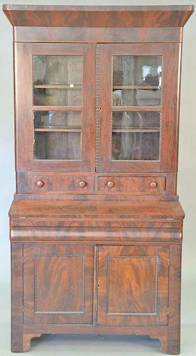 Empire mahogany secretary desk in two parts, circa 1840. ht. 80 in., wd. 40 in.