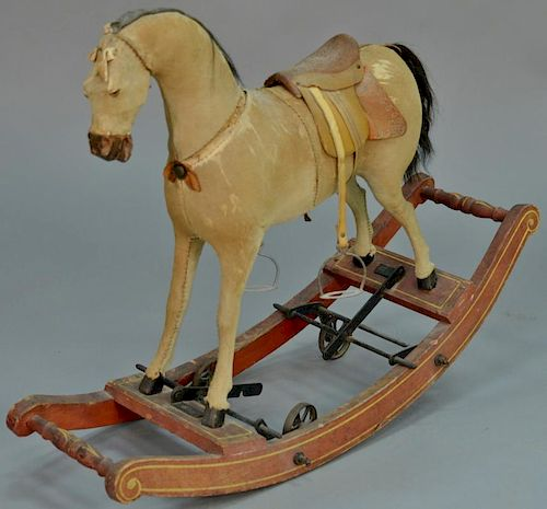 Rocking horse with wheels, hyde covered (seam splitting).  height 26 inches