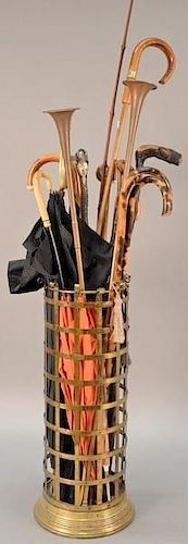 Brass umbrella holder (ht. 24in.) with canes and umbrellas, two copper horns, one silver handled umbrella mounted with stones