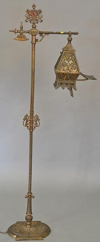 Iron floor lamp with mica shade. ht. 63 in.  Provenance: From the Estate of Faith K. Tiberio of Sherborn, Massachusetts
