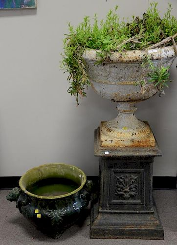 Two piece planter group to include iron two part outdoor urn on pedestal (ht. 40in.) and ceramic green