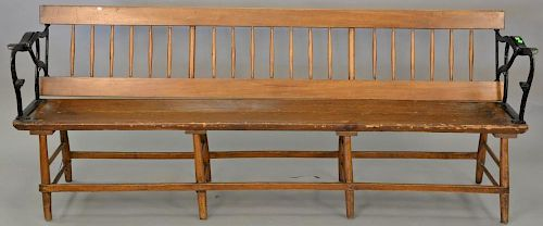 Railroad plank seat bench with iron arms and reversible back. lg. 84 in.  Provenance: Property from the Estate of Frank Perro