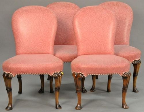 Set of four custom upholstered Queen Anne style side chairs.