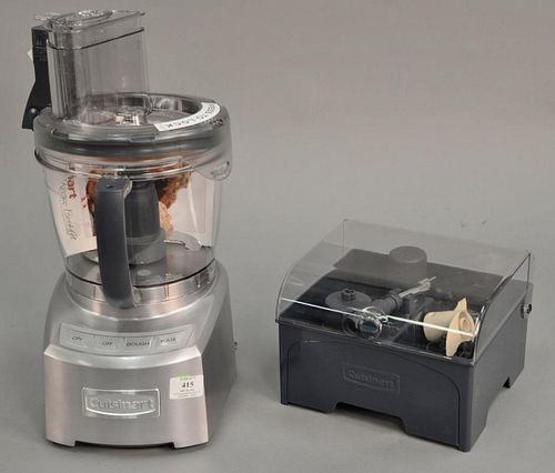 Cuisinart Elite food processor with set of different blades, having new stickers and book (ht. 17in.).   Provenance: The Esta