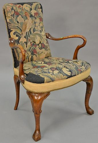 Queen Anne style open armchair with needlepoint upholstery.