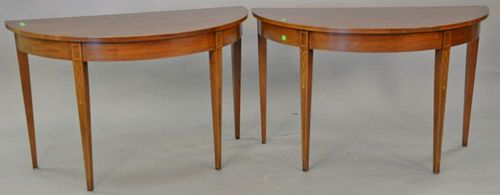 Pair of mahogany half round demilune tables. ht. 29 in., wd. 47 in.