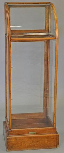 "Two piece lot to include an oak store display on stand (ht. 41 in., top: 16"" x 18"") and store display cabinet with curved gla"