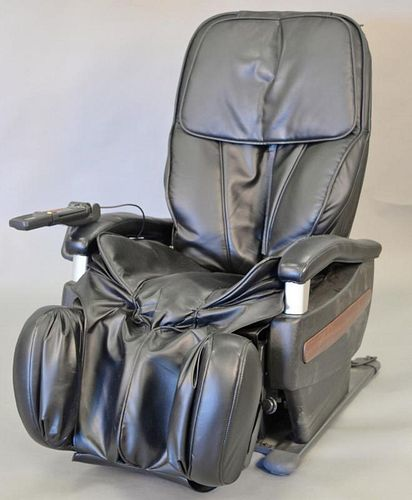 Massage chair, electric with controller.  Provenance: From the Estate of Faith K. Tiberio of Sherborn, Massachusetts
