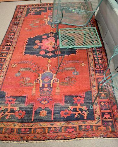 """Oriental area rug. 5'6"""" x 10'"""